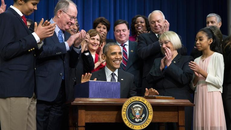 President Barack Obama signs S. 1177, Every Student Succeeds Act (ESSA), during a bill a signing ceremony in the Eisenhower Executive Office Building South Court Auditorium, Dec. 10, 2015. (photo credit: Evan Vucci/AP)