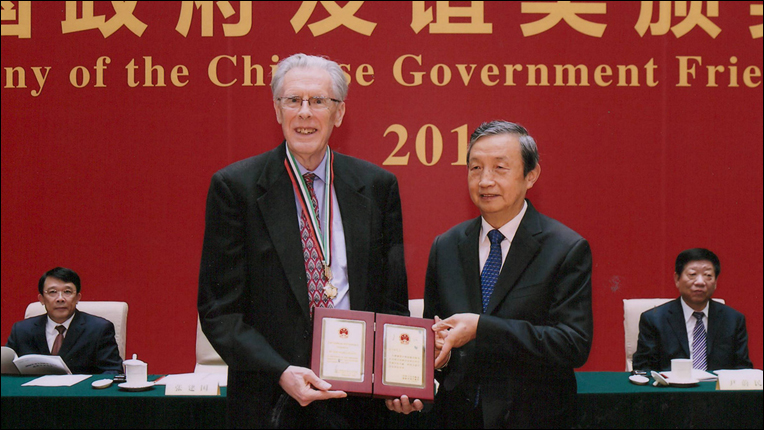 Image of Turing Award Laureate John Hopcroft receiving the China Friendship Award
